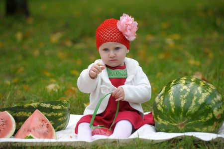 The little girl with a water-melon photo