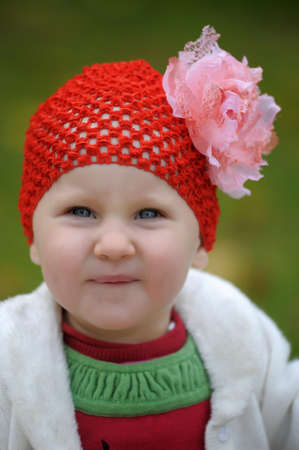 Little girl in a red hat photo