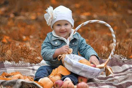 The little girl with a basket of apples Stock Photo - 11037136