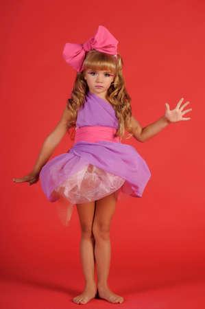 Pretty girl pretending to be a Barbie doll  photo