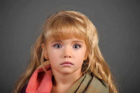 The little girl muffled in a scarf to be warmed  Stock Photo - 11036797