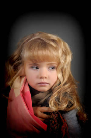 The little girl muffled in a scarf to be warmed Stock Photo - 11036799