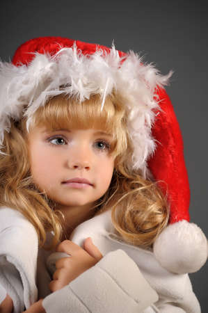 little blonde with a Christmas hat photo