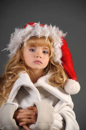 little blonde with a Christmas hat Stock Photo - 11020001