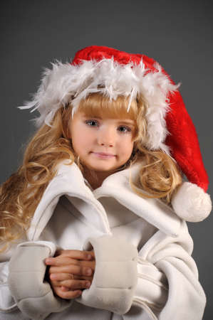 little blonde with a Christmas hat Stock Photo - 11020002