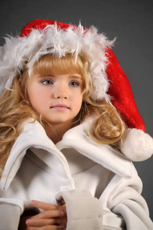 little blonde with a Christmas hat Stock Photo - 11020008