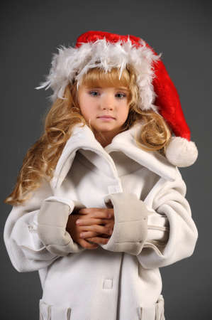 little blonde with a Christmas hat Stock Photo - 11019999