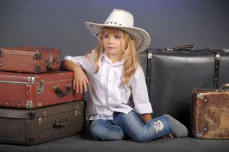 horse blonde: little girl in a white cowboy hat Stock Photo