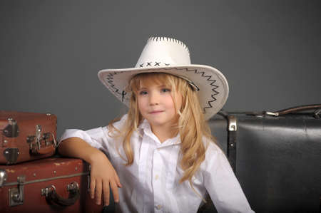 little girl in a white cowboy hat photo