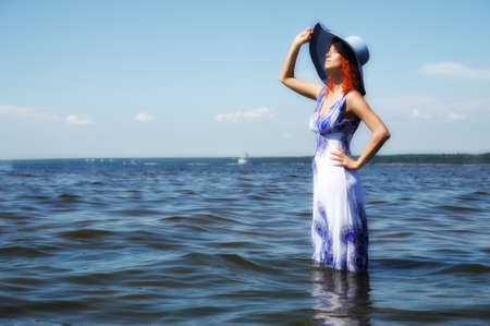 Young fashion woman on the beach  photo