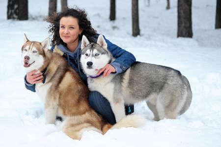 winter break: woman with two husky Stock Photo