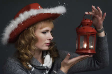 young woman with a Christmas lantern in hand photo