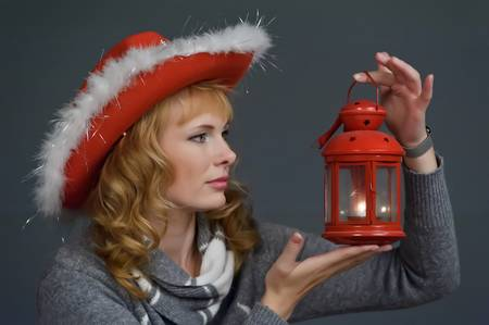 young woman with a Christmas lantern in hand Stock Photo - 11574540