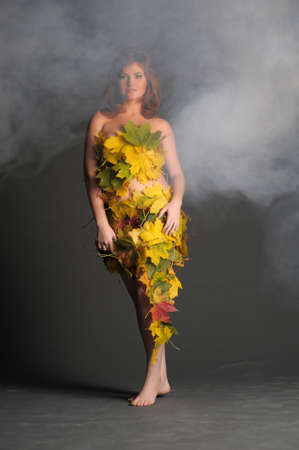 Beautiful woman in lingerie of autumn leaves Stock Photo - 11422784
