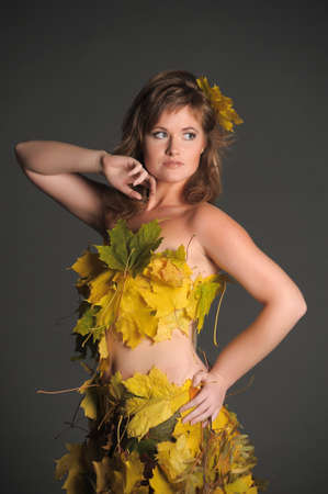 Beautiful woman in lingerie of autumn leaves Stock Photo - 11422829