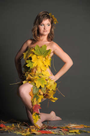 Beautiful woman in lingerie of autumn leaves Stock Photo - 11422830