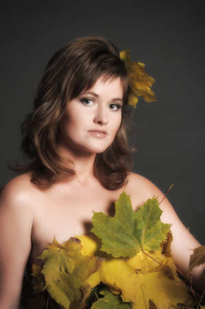 Beautiful woman in lingerie of autumn leaves Stock Photo - 11422816