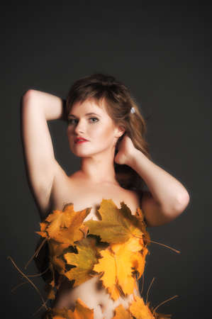 Beautiful woman in lingerie of autumn leaves  Stock Photo - 11422788