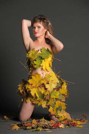 Beautiful woman in lingerie of autumn leaves  Stock Photo - 11422854