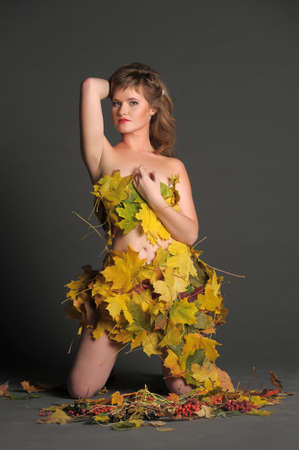 Beautiful woman in lingerie of autumn leaves Stock Photo - 11422821