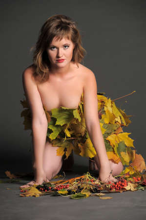 Beautiful woman in lingerie of autumn leaves  photo
