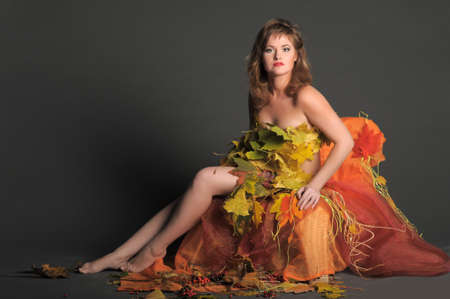 Beautiful woman in lingerie of autumn leaves Stock Photo - 11422802