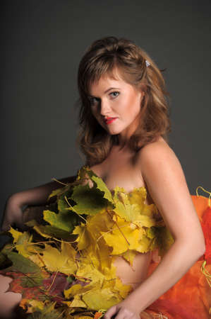Beautiful woman in lingerie of autumn leaves  Stock Photo - 11422837