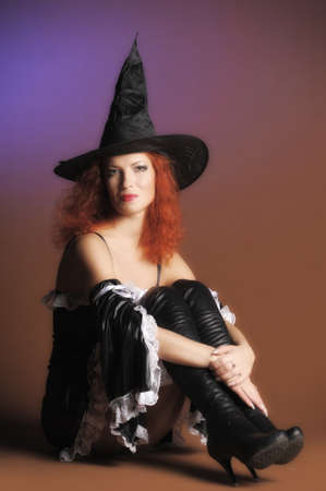 belonging to the caucasoid race: redheaded witch Stock Photo