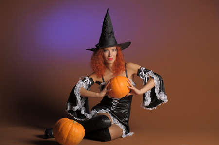 harmonous: Beautiful red-haired witch with a pumpkin