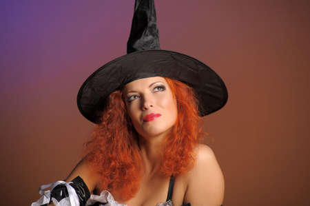 Sexy redheaded witch photo