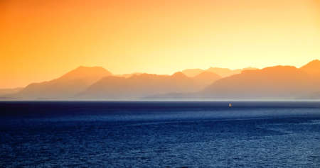 Beautiful decline over the sea and mountains  photo