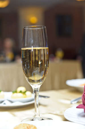 Glass with champagne on a festive table  Stock Photo - 11170371