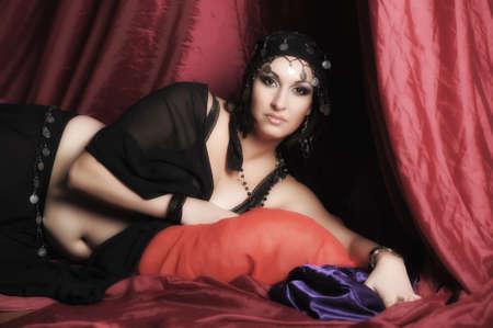 Beautiful Belly Dancer Lying Down Stock Photo - 11868884