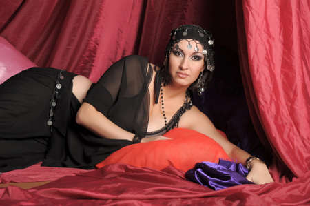 Beautiful Belly Dancer Lying Down Stock Photo - 11868866