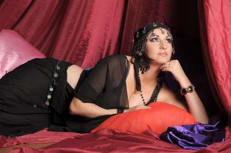 Beautiful Belly Dancer Lying Down Stock Photo - 11868867