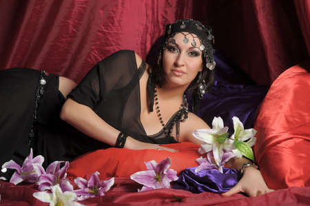 Beautiful Belly Dancer Lying Down  photo
