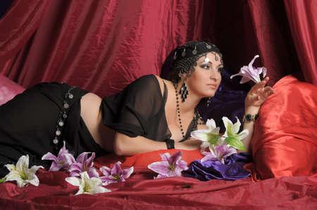 Beautiful Belly Dancer Lying Down Stock Photo - 11868872