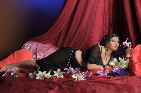 Beautiful Belly Dancer Lying Down Stock Photo - 11952898