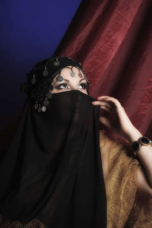 Beautiful asian girl with black veil on face  photo