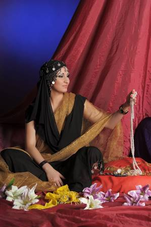 Shot of an oriental woman in a traditional costume Stock Photo - 11489556