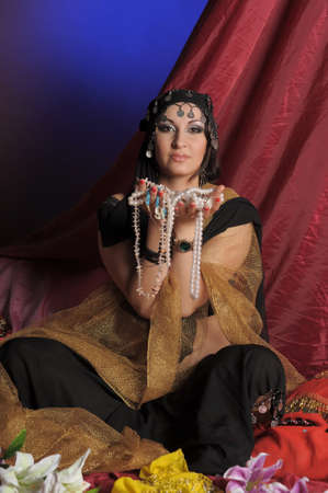 arab glamour: Shot of an oriental woman in a traditional costume Stock Photo