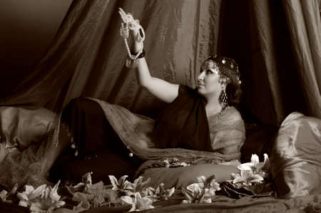 East woman reclining on pillows  photo