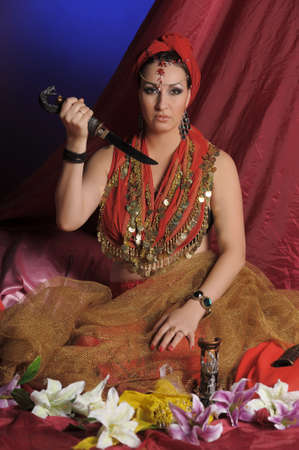 gruesome: Shot of an oriental woman in a traditional costume.  Stock Photo