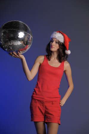 Santa-rina holding a disco ball photo