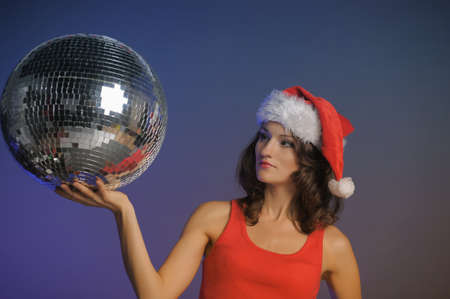 Santa-rina holding a disco ball photo