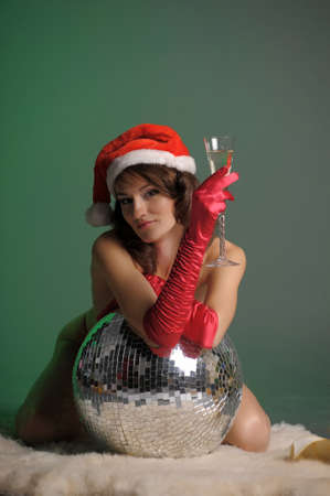 young woman in a santa hat and a glass of champagne Stock Photo - 11489349