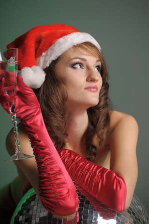 young woman in a santa hat and a glass of champagne Stock Photo - 11489357