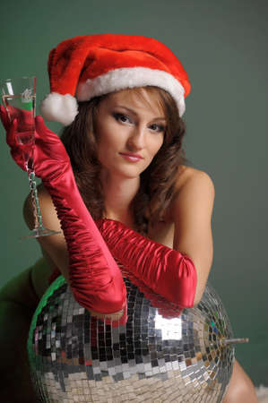 young woman in a santa hat and a glass of champagne Stock Photo - 11489379