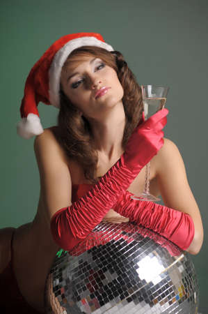 young woman in a santa hat and a glass of champagne Stock Photo - 11489368