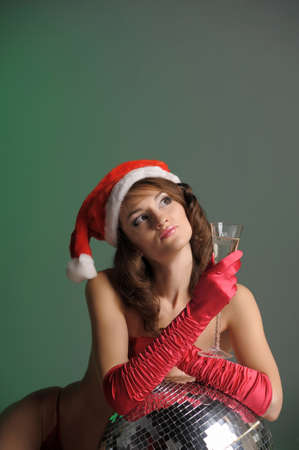 young woman in a santa hat and a glass of champagne Stock Photo - 11489378